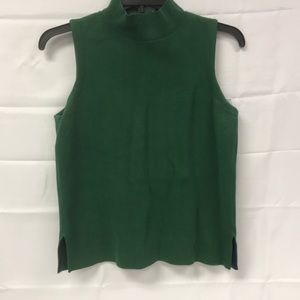 Green mock neck turtle next Moth by Anthropologie